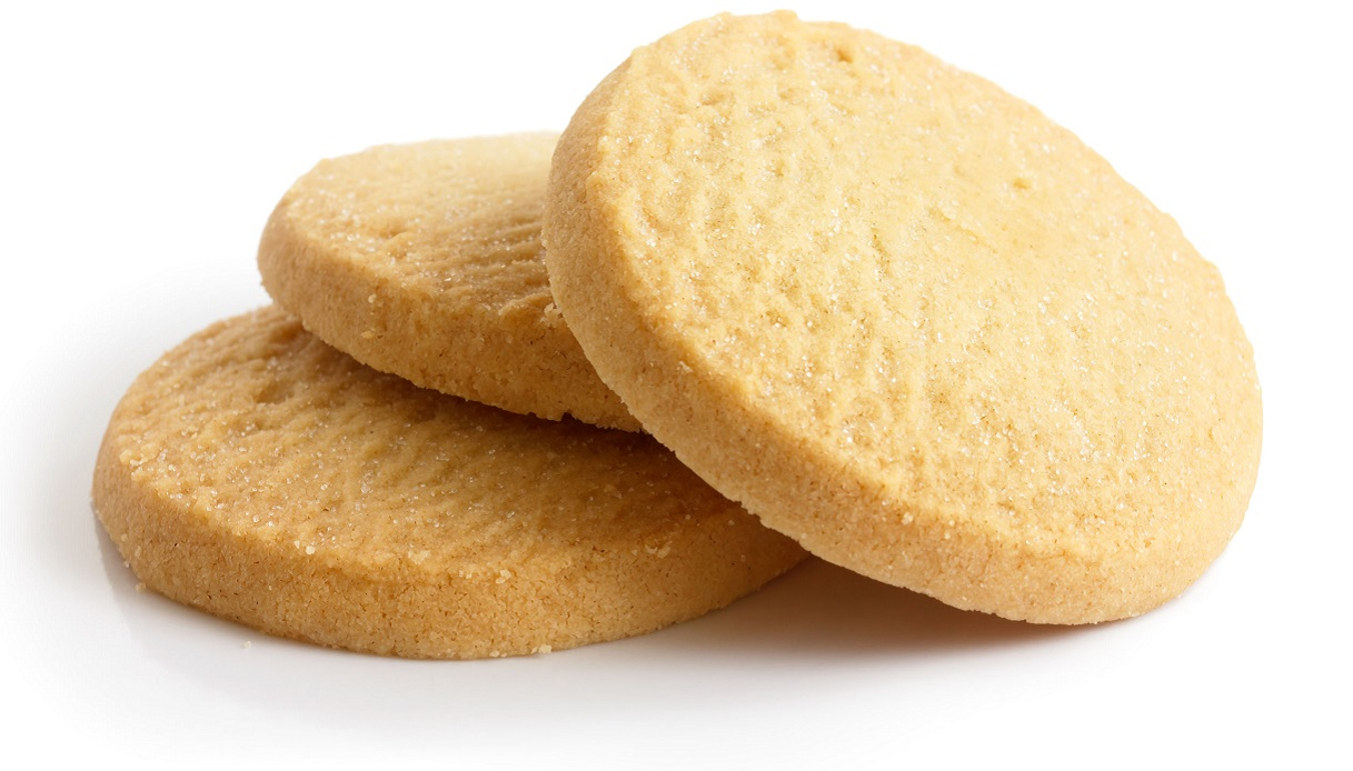 44579927 - three round shortbread biscuits isolated on white.